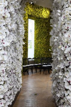 Runway staging for Christian Dior Fall/Winter 2012 Haute Couture during Paris Fashion Week. The walls of flowers by Parisian florist Eric Chauvin.