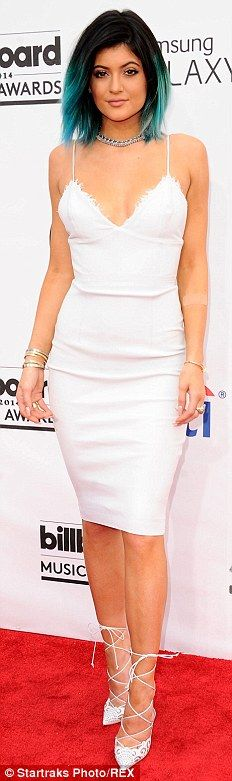 Stand-out style: Kylie Jenner, 16, opted for a tight white midi-length frock and white leo...