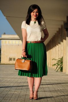 if it's green and pleated then it's perfect...love it with the camel color!