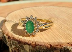 A vintage 18k yellow gold emerald and diamond ring.