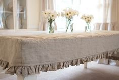 burlap 'slipcover' type tablecloth. My sister made these in white and used burlap tablerunners...they are SO pretty and versatile