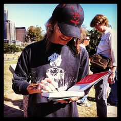 Shawn Sahm Signing a copy of Texas Tornado The Life And Music Of Doug Sahm