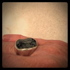 Gorgeous Silpada .925 Sterling ring Gorgeous and unique ring in .925 sterling silver and feldspar. Great tooling on the silver gives it texture and the curved setting of the feldspar stone is an eye catcher. Stamped with Silpada trademark and .925. Excellent condition. Silpada Jewelry Rings