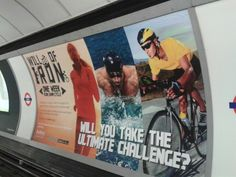 Challenge event ad in tube station - the charity/cause is barely visible
