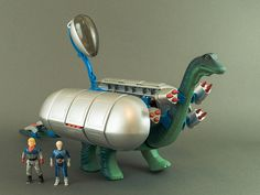 Tyco's Diplodocus, a motorized walking dinosaur with battle gear, came packaged with heroic Dino-Riders Questar, Mind-Zei, and Aries