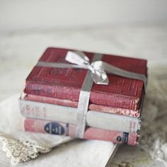 vintage books and ribbon - beautiful idea...group several old books together with a vintage ribbon and display.