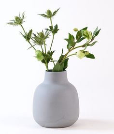 Large handmade chubby ceramic vase in matt grey. The vase is high quality porcelain inspired by the Nordic design tradition, modern Scandinavian design and