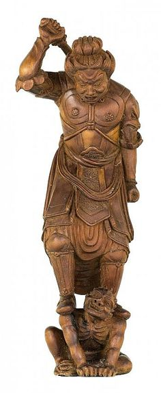 JAPANESE CARVED WOOD NETSUKE OKIMONO Contemporary. Signed Akihide. Of Bishamon and Oni. Height 4 3/4 inches. Literature: Living Masters of Netsuke by Miriam Kinsey, page 93, illustrated.