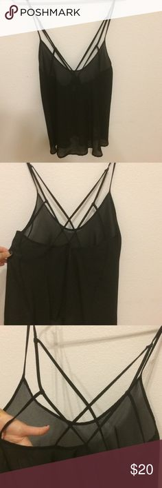 Free People Strappy Back Black Tank Super cute and stylish simple black chiffon tank top from Free People with spaghetti straps and a super cute strappy back. Lovely shirt it's just too big for me. Never worn. Size M. Prices are negotiable, make me an offer. Free People Tops Tank Tops