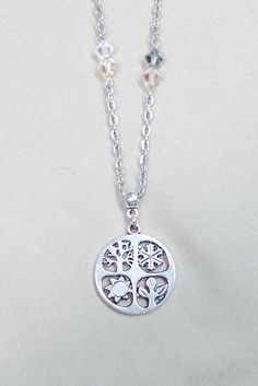 Four Seasons pendant necklace with Swarovski crystals by DLSLimited on Etsy