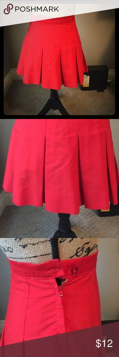 Vintage cheer skirt This is an adorable vintage red cheer skirt. It has a 12in waist laying flat and it is 15in long laying flat. It has a zip and button side and would look so cute as an everyday skirt. My dress form is a little too big for the skirt so it wouldn't button. But it does button up and the zipper does work. Also all items are vintage so it has been preloved and may show it's age. But don't stop that from letting it join your wardrobe Vintage Skirts Mini