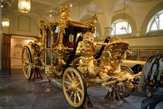 Gold State Coach housed in the Royal Mews beside Buckingham Palace