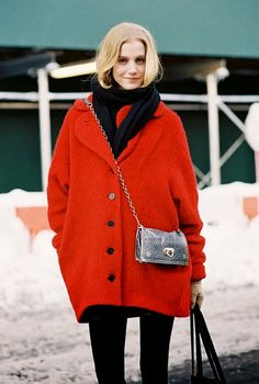 Cheery bright red coat worn with an on-trend metallic cross-body purse.