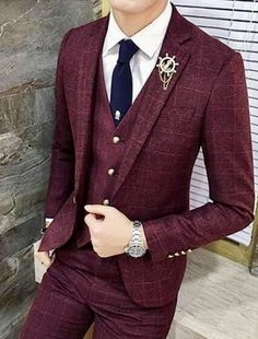 Men's three piece burgundy red suit with gold buttons and blue tie. #theclassypeople #gentlemen #mensfashion #menswear #menstyle #bespoke #suits #business #giorgentiweddings #wedding #groomsmen #fashion #mensguides #mens