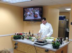 Chef Mark Kalla preparing ingredients for a recent Cape Cuisine cooking demo.