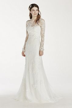 22918a1d45d2 Long sleeved lace sheath with ribbon and lace applique detail features  illusion neckline and deep v back. Signature eyelash trim on neckline and  sleeves.