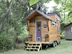 Love this tiny house on wheels, complete with rooftop deck!