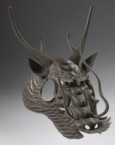 Baman (horse mask), attributed to Fukutake Ichiro (1928 - 2002) Japan, Showa period, 20th century Length: 24 1⁄2 inches, 62.5 cm Width: 15 3⁄4 inches, 40 cm An iron horse mask, bamen, in the form of a fierce dragon's head, hammered in separate sections that are riveted together and with two side panels that are attached to the main mask with leather straps.