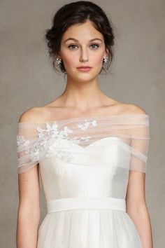 Romantic shrug by Jenny Yoo. The embroidered #tulle with Fleur #Lace Applique is a stunningly detailed addition to any #gown.