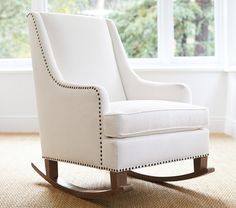 A large upholstered chair or a slipcase-covered glider with enough room for you and your baby, paired with a lamp and an end table, provides a cozy spot for spending time together now, and can live nicely in another room later.