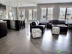 Clean tile to hardwood floor transition.  Looks seamless and very nice.