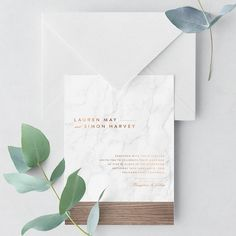 The Modern Marble Wedding Invitation Suite takes inspiration from Nordic and industrial design - it combines marble, wood and copper foil to create a chic new look perfect for any contemporary wedding.