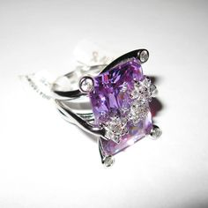 Modern Brass Rhodium Lavender Topaz CZ Cocktail Fantasy Ring R-41-65LAVCZ            Rhodium Metal CZ Lavender Topaz  Listed on Sep 15, 2011Listing # 81826793  Report this item to Etsy  $129.00 USD