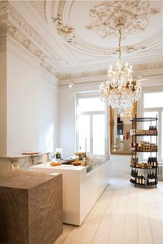 white wall, wooden floors, counters... Boxy Fine Foods With JORDAO COOLING SYSTEMS http://www.jordao.com/pt