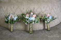 Bride / bridesmaids bouquets with beautiful lace wrap
