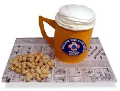 Very detailed directions on making and assembling beer cake with meringue foam head.