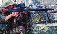 Coloured photo from WWII. Waffen SS MG42 team. Gunner in Italian camo pattern trousers.
