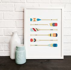 Nautical print of colorful painted boat paddles. Fun coastal beach print is great at the beach house or cabin, or also just as a nautical and