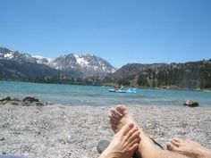 Very few places on Earth can you lay on a beach at 90 degrees and see snow covered mountains. Here's one at June Lake, Ca. We've been to a few others. There are lots of California beaches where the snow covered mountains are behind you. (Like Long Beach). But we have found very few that meet the temp and view criteria. If you know of any just pin.