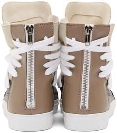 Leather Classic Multi-Laces Sneakers in beige by Krisvanassche. High-top leather sneakers in beige, black and gray. Round-toe. White multi-lace closure at vamp. Oversized supple tongue. Pebbled-grain trim in black throughout. Zip closure at heel counter.  http://www.zocko.com/z/JJXBp