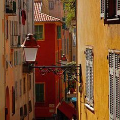 Narrow street in Le Suquet, the old town of  in Cannes, France