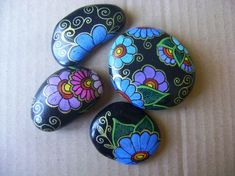 Blue and purple Daisy flowers painted rocks.