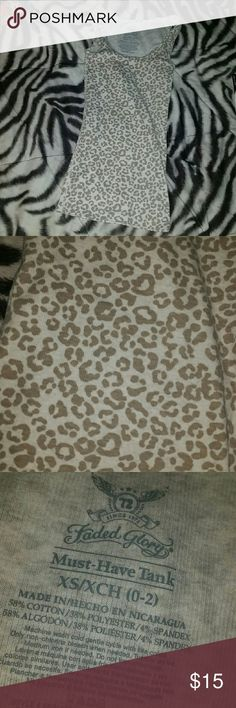 "Faded Glory Cheetah/Leopard Print ""Must Have Tank"" Faded Glory Cheetah/Leopard Print ""Must Have Tank"", size xs (0-2) ! EUC or better ! Superr cute, extra comfy & looks great on ! Perfect for this upcoming summer weather ! Received from another posher, but unfortunately I don't like the way it looks on me 😢👎 So I am re-poshing .. My loss, your gain 😄👍  CROSS-POSTED !!!!  💞Trades are welcomed, but would prefer to sell..💞 Faded Glory Tops Tank Tops"