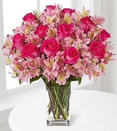 This shows a pattern by placing the pink flowers then roses, then pink flowers then roses, and so on. Flower Centerpieces, Flower Vases, Flower Decorations, Amazing Flowers, Silk Flowers, Beautiful Flowers, Beautiful Flower Arrangements, Floral Arrangements, Cemetery Flowers