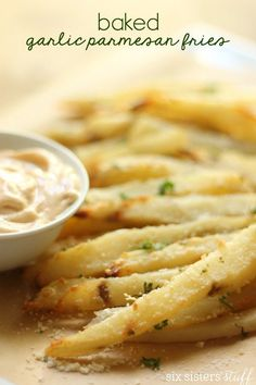 These Garlic Parmesan Fries are BAKED, so you can feel a lot better about eating half the pan! ;)