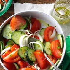 Garden Tomato Salad Recipe -For as long as I can remember, Mom made a salad of tomatoes and cucumbers. Now I make it whenever beautiful tomatoes are in reach. —Shannon Arthur, Wheelersburg, OH