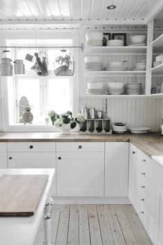 Gorgeous counter.  Has me rethinking butcher block.  Maybe sand down and do a light white/grey stain?