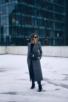 Style and beauty blogger Jill Lansky of The August Diaries in H&M plaid coat with Celine black box bag, GRLFRND jeans
