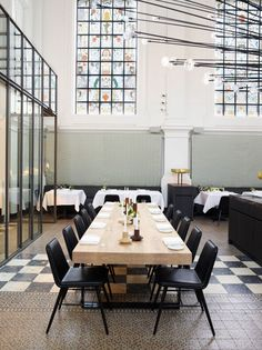 Michelin star restaurant The Jane in Antwerp. Fredericia furniture the spine chair in black leather designed by Space Copenhagen.