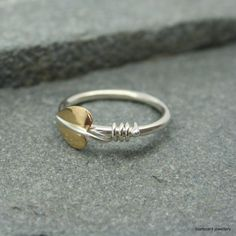 Silver and brass leaf ring with silver stem by starboardjewellery