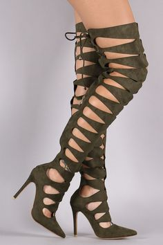 """Description These fashionable  over-the-knee boots  feature a strappy keyhole cutout shaft with corset-style lace up design, pointy toe silhouette, and stiletto heel. Finished with lightly padded insole and partial back zip closure for easy on/off.Material: Vegan Leather (man-made)Sole: Synthetic  Measurement Heel Height: 4.1"""" (approx)Shaft Length: 27.75"""" (including heel)Top Opening Circumference: 16"""" (approx) 