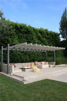 Build my own seating with storage for cushions and pillows. modern metal pergola