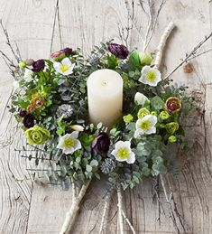 Create Sarah Ravens Eucalyptus Wreath centrepiece. Includes Wreath, Hellebore Spray, Ranunculus Arrangement, Large Ivory Pillar Candle, Silver Pine Cones