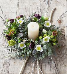Create Sarah Ravens Eucalyptus Wreath centrepiece. Includes Wreath, Hellebore Spray, Ranunculus Arrangement, Large Ivory Pillar Candle, Silver Pine Cones