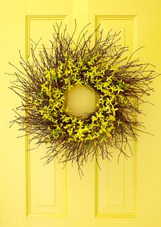 Scour your yard for a collection of tiny twigs to use for this DIY fall wreath. With florist's glue, attach the twigs to a metal wreath form and display on your fall front door. #falldecor #fallideas #wreathideas #fallwreath #wreath #bhg