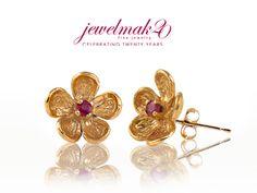 Elegance, meet Cuteness     Ruby centered in 14ky flower studs